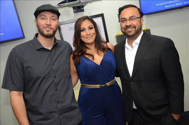 IN D'JUNCTION: Entrepreneur and innovator of D'Junction Mobile App Ria Karim is flanked by local soca artiste Chromatics, left, and Shyamal Chandradathsingh at the app's Carnival 2019 launch.